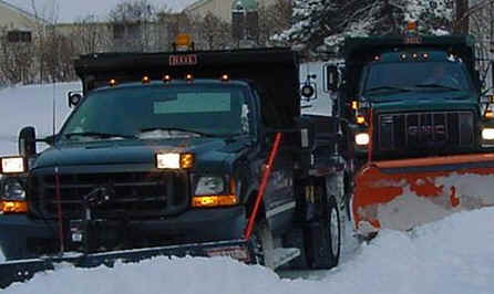 2 Black Plow Trucks Pushing Snow
