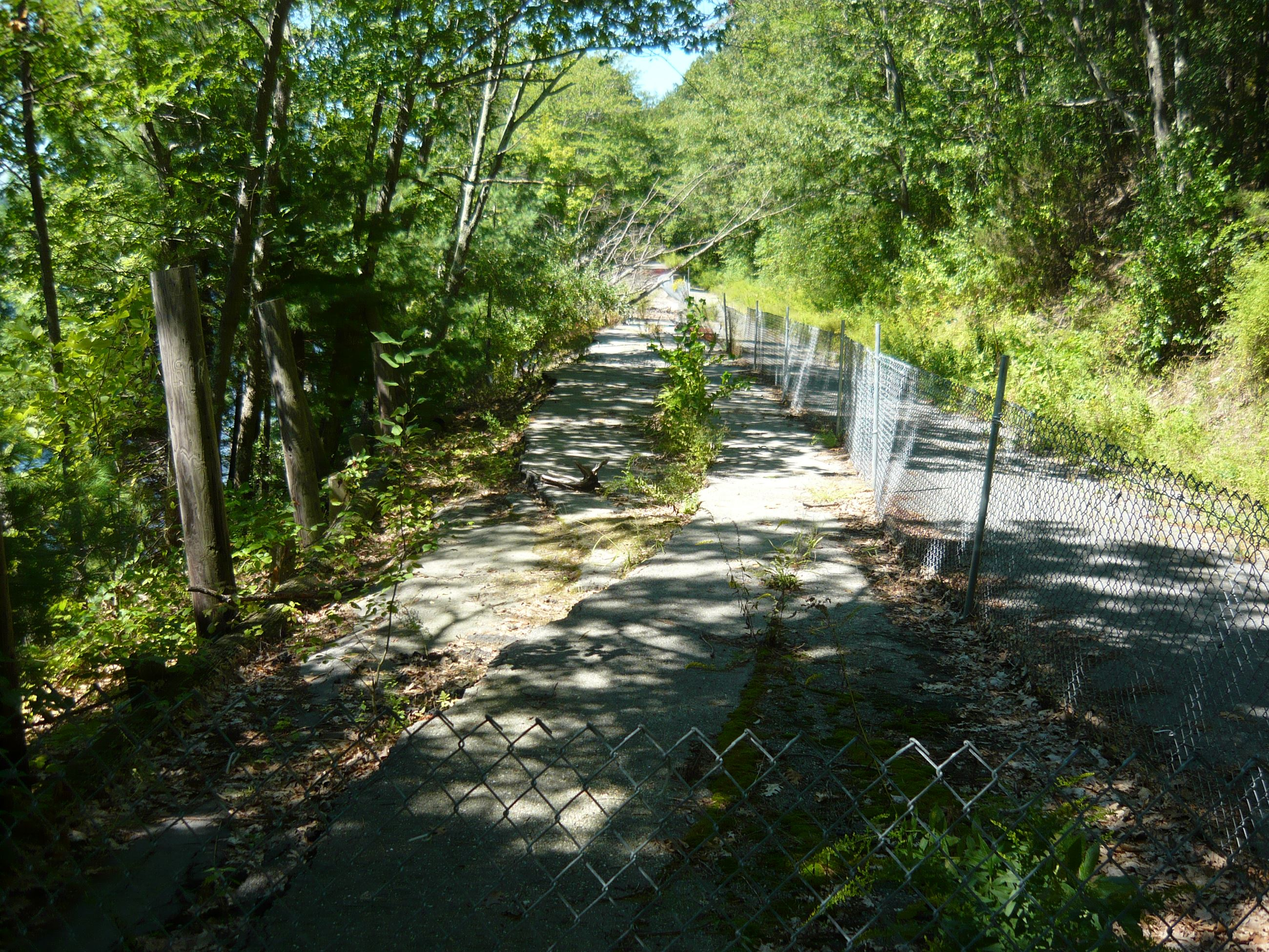 Broken Road with Fence Surrounding